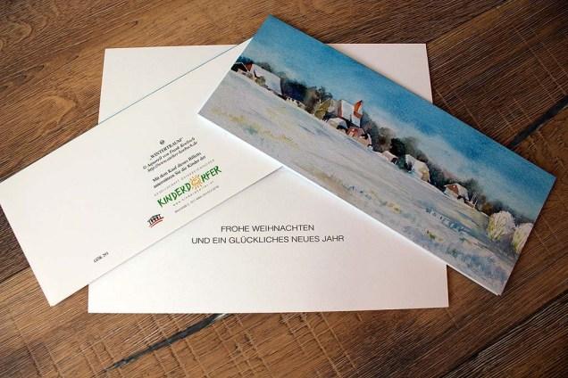 Weihnachtskarte der SOS KInderdöfer at mit dem Aquarell Wintertraum von Frank Koebsch