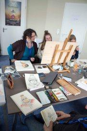 Bei Regen malten die Karikaturisten im Hafenhaus Kühlungsborn (c) FRank Koebsch (1)