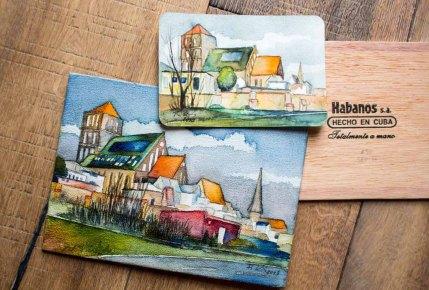 Aquarelle von der Rostocker Nikolaikirche auf einem Zigarrenkistenbrett und als Aquarellpostkarte (c) Frank Koebsch